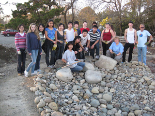 Volunteers posing with rock they lay out