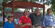 Board member Bob Swanson talks about the weather station he is installing at the garden